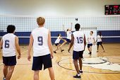 stock photo of netball  - High School Volleyball Match In Gymnasium - JPG
