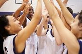 foto of 13 year old  - High School Sports Team Celebrating In Gym - JPG