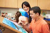 picture of 13 year old  - Male Pupil In High School Art Class With Teacher - JPG