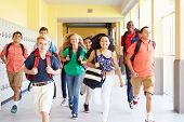 picture of 13 year old  - Group Of High School Students Running Along Corridor - JPG