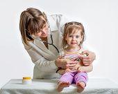 Doctor Examining Child Girl