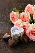 gold ring with diamond and bouquet pink roses