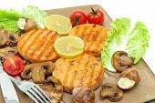 Roasted Salmon Medallions With Mushrooms And Vegetables Closeup