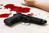 stock photo of gun shot wound  - concept shot of the crime scene of shooting - JPG