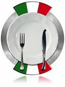 foto of italian flag  - Concept of Italian cuisine with empty white plate and silver cutlery on metal circle with two italian flags isolated on white background - JPG