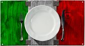 image of italian flag  - Concept of Italian cuisine with empty white plate and silver cutlery on Italian wooden flag isolated on white background - JPG