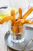 stock photo of churros  - Homemade Churros in a glass by chocolate sauce