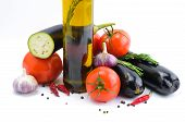 Fresh vegetables and olive oil bottle isolated on a white background