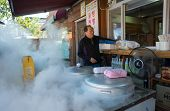 JEONJU, SOUTH KOREA - 03 NOVEMBER 2014: A chef prepares to steam red bean paste buns in a restaurant in the Jeonju Hanok village. The steamed buns is a traditional delicacy in South Korea.