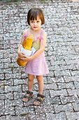 Little Girl Holding S A Loaf Of Bread