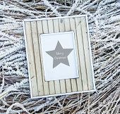 Old Wooden Frame Over Frozen Grass. Merry Christmas