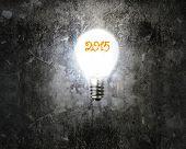 Bright 2015 Light Bulb Illuminated Dark Old Mottled Concrete Wall