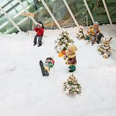 Christmas Decorations With Dwarfs Skiing On In The Forest.