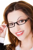 Portrait of woman in eyewear looking at the camera.