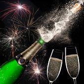 Champagne explosion on black background, celebration theme.