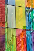 Urban Reflections On Colored Windows Of Convention Center Montreal