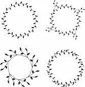 Hand-drawn silhouettes branches wreaths graphic design elements set