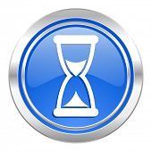 time icon, blue button, hourglass sign