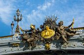 Постер, плакат: Nymphs of the Seine relief on the ornate Pont Alexandre III bridge