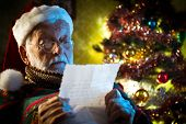 Santa claus reading mail pic.