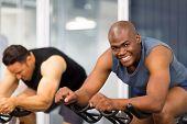 healthy men on gym bike