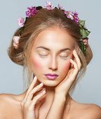 Lovely Model With Shiny Volume Curly Hair With Flowers, Winter White Eyelashes Make-up, Vivid Lips A