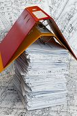 Big Heap Of Design And Project Drawings Under Yellow And Red Folders