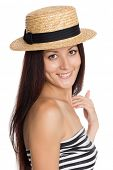 Smiling young girl in a straw hat. Girl of twenty-seven years.