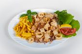 fried calamari, fried squid with lemon and french fries