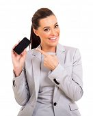 pretty career woman pointing at smart phone on white background