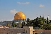 Jerusalem, Israel. The golden dome of the mosque of Omar shines in the morning sun.