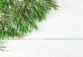 Christmas Frame Of Pine Tree Branches. Wood Background