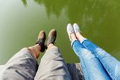 Couple legs wite lake