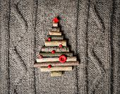 Christmas warm knitted background with new year tree decorations made of sticks. Vintage christmas c
