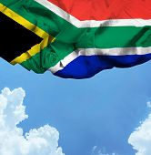 South Africa waving flag on a beautiful day