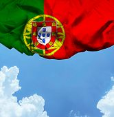 Portugal waving flag on a beautiful day