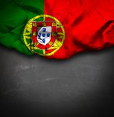 Portugal waving flag on blackboard