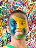 Little Brazilian boy painted the flag of Brazil in Salvador, Bahia.