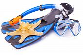 Blue diving goggles,snorkel and flippers. isolated
