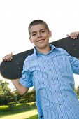 Teenager With His Skateboard