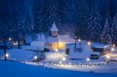 Small village in the snowy mountains in winter night