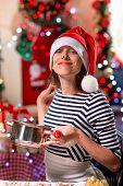 Woman tasting something tasty on Christmas