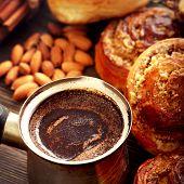 coffee and cinnamon rolls on wooden blackboard