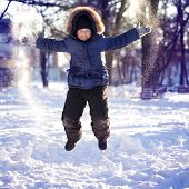 happy boy jump outdoors