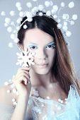 Beautiful frozen woman on blue background