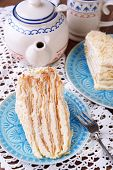 Napoleon cake with tea on table close-up
