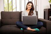 Pretty Girl Using A Laptop