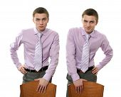 Two young businessmen leaning on chairs isolated on white