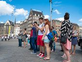 Tourists Take Picturesin Dam Square - Amsterdam