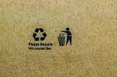 stock photo of recycled paper  - Close up photo of the recycle symbol printed on a recycled cardboard box background - JPG